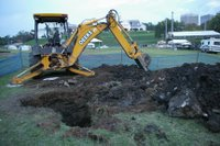 The backhoe and some of the debris removed from the pit