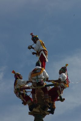 Shaman David Garcia dances on the top of the pole.