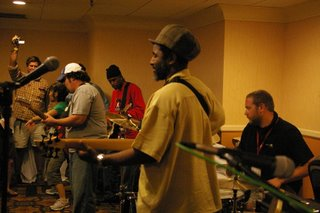 Sticks and strings: Alonzo Pennington (with Telecaster, left), Tino Jackson, Ralphtafari, and Steve Lecky (on drums)